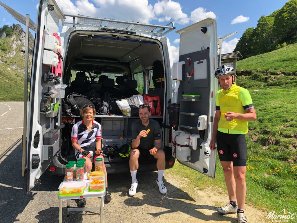 Marmot Tours van interior and clients on a road cycling holiday in Europe