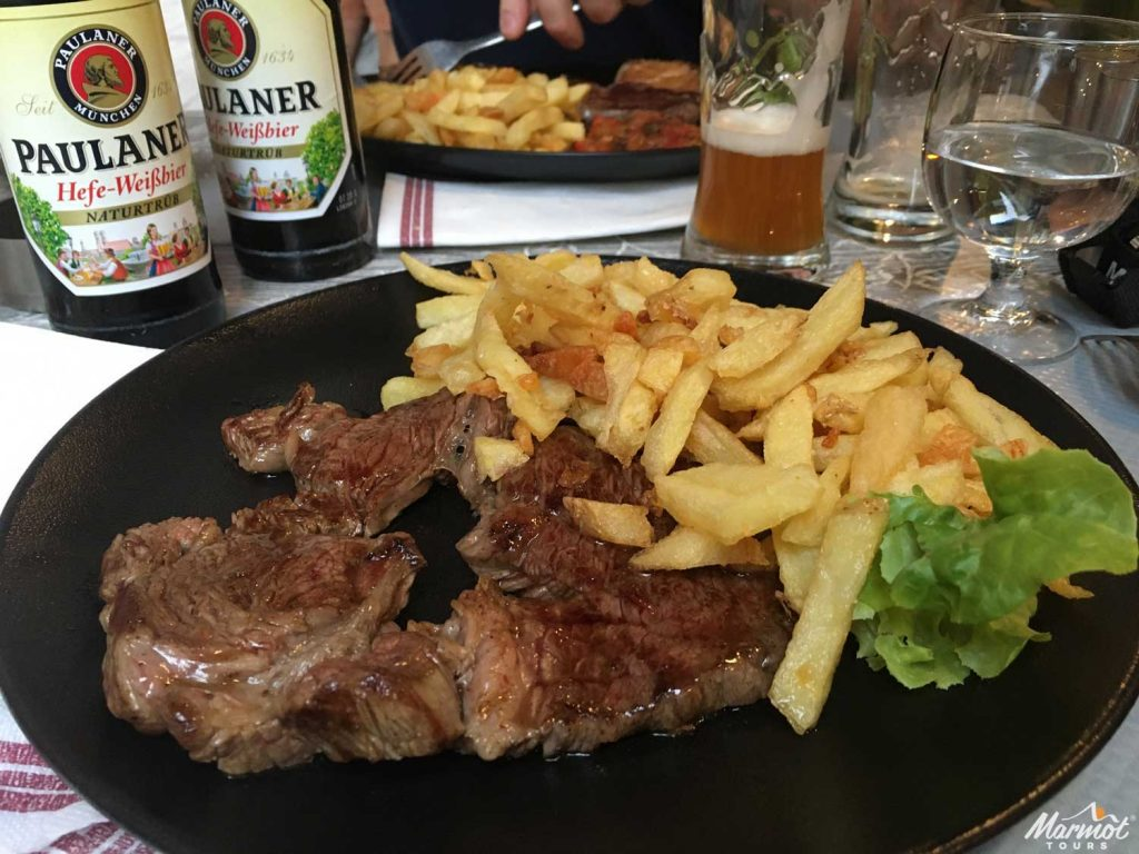 Steak and chips on Marmot Tours road cycling holiday in French Pyrenees