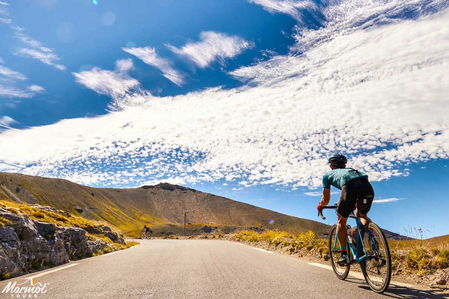 Cyclists on Raid Alpine road cycling challenge with Marmot Tours European road cycling holidays