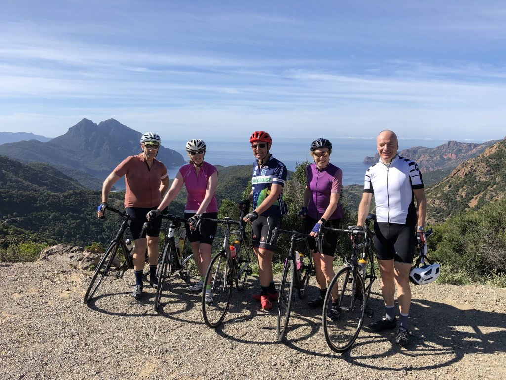Group of cyclists with coastal view on fully supported road cycling holiday with Marmot Tours