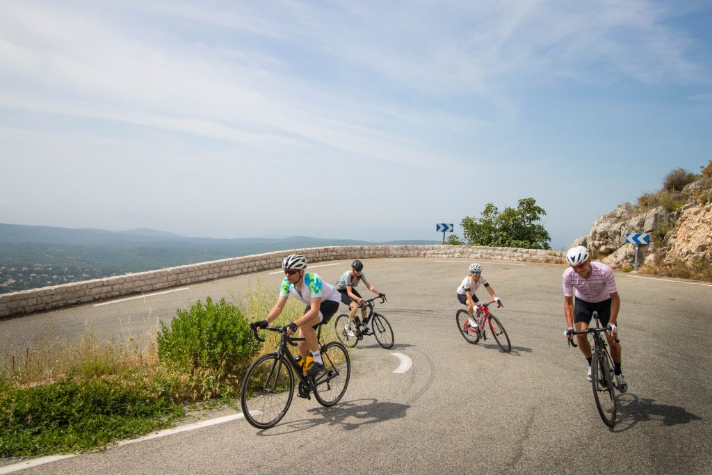 Group of cyclists on hairpin bend with Marmot Tours fully supported European road cycling holidays