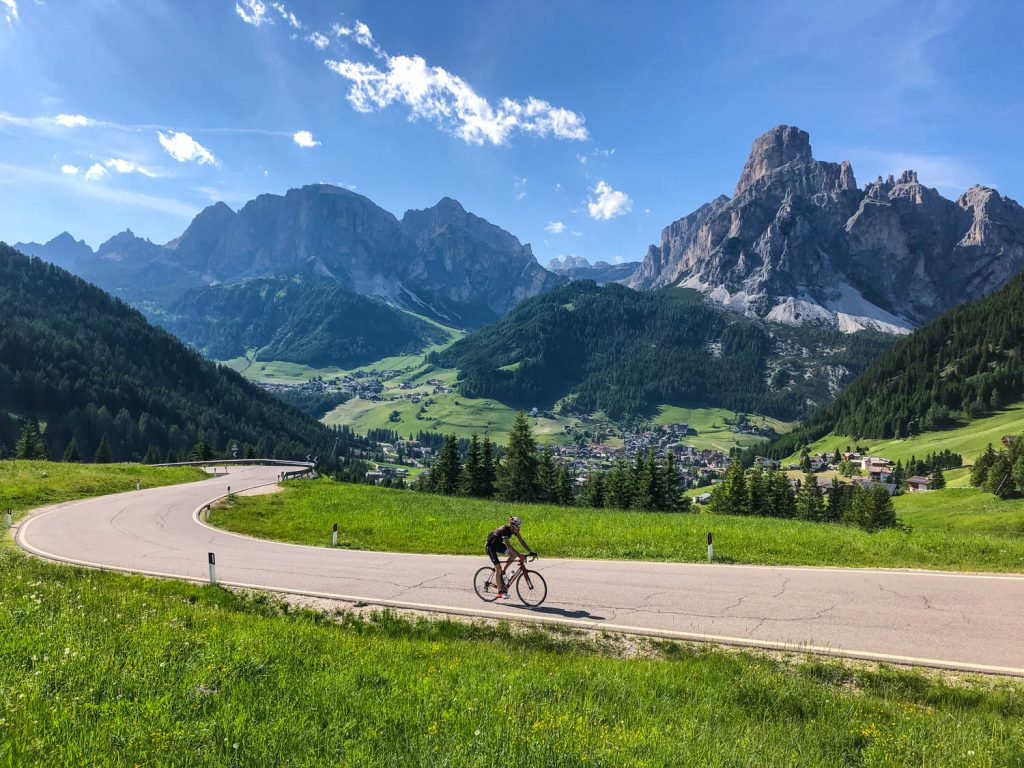 Cyclist with beautiful backdrop of Italian Dolomites on Marmot Tours European road cycling holidays in Italy