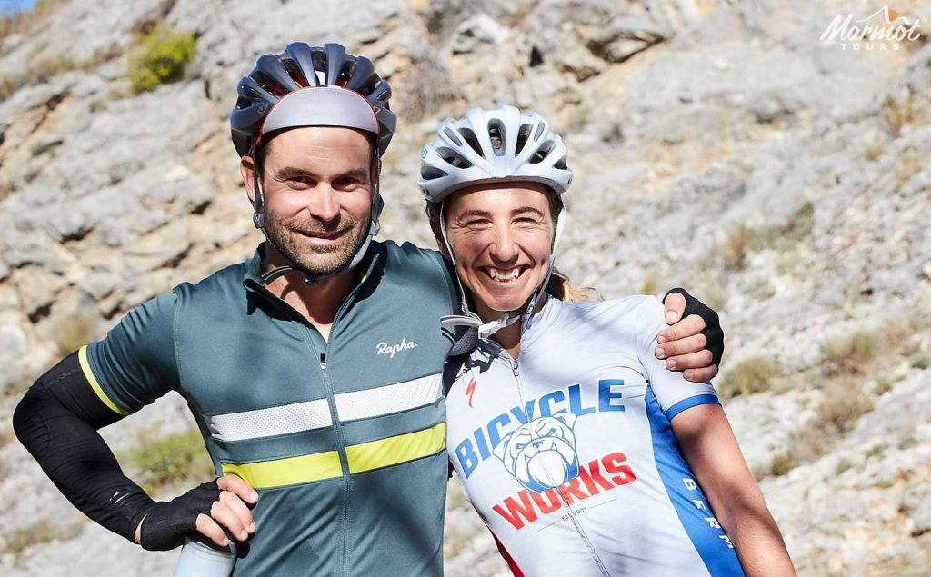 Couple of cyclists embracing on Marmot Tours road cycling holiday in Provence