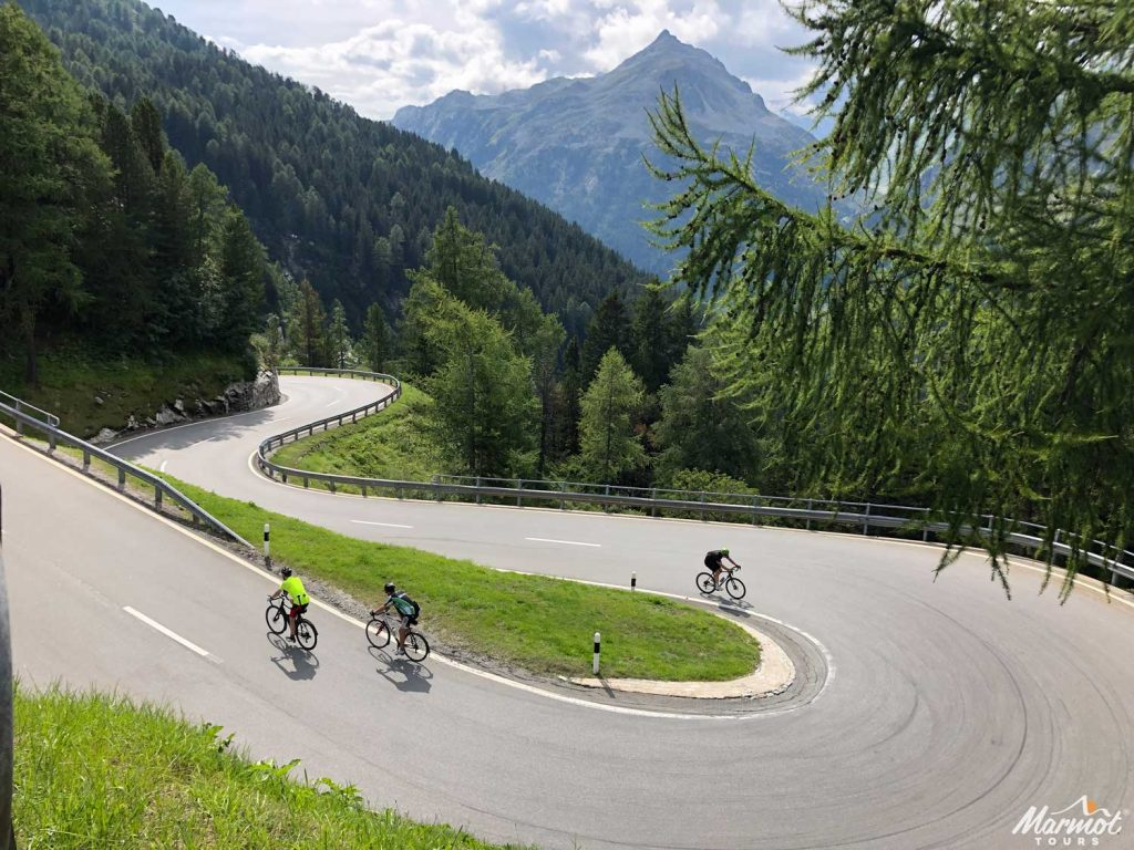 Three cyclists on bend with Marmot Tours road cycling holiday in the Italian Dolomites