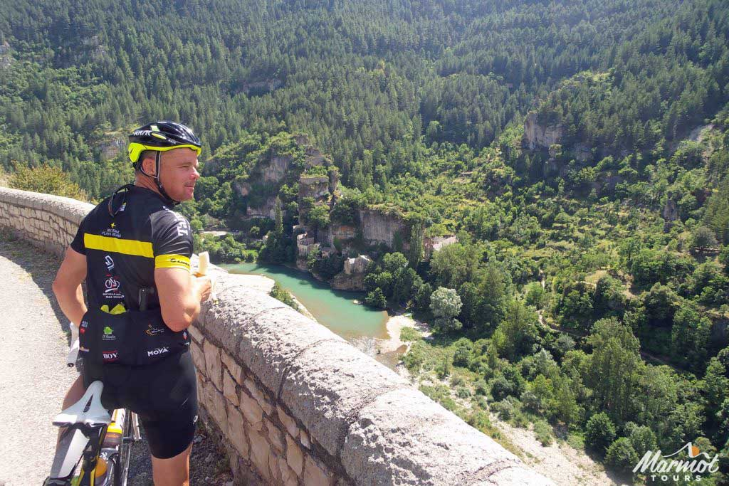 Cyclist overlooking gorge on Marmot Tours French cycling holiday in the Cevennes and Ardeche