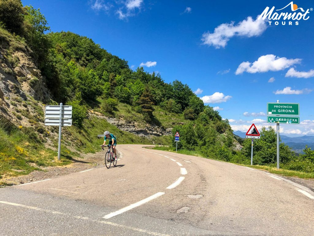 Cyclist descending on guided Girona cycling holiday with Marmot Tours