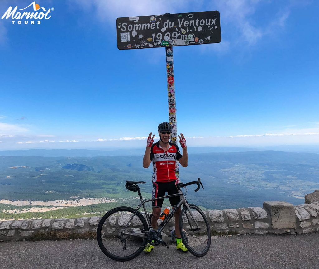 Cyclist on summit of Mont Ventoux with Marmot Tours fully supported Ventoux Club des Cingles Challenge