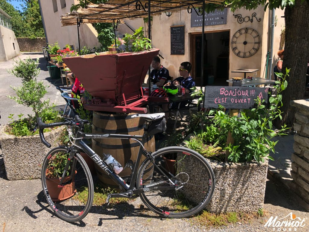 Bike outside café on French cycling holiday with Marmot Tours