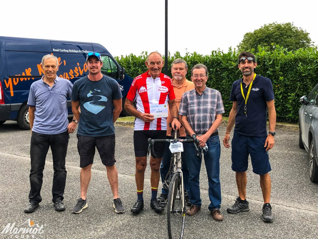 Marmot Tours cyclist presented with certificate for being 10,000th participant of Raid Pyrenean by Cyclo Club Bearnais and Marmot Tours guides on road cycling holiday in Pyrenees