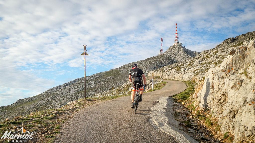 Cyclist approaching summit of Gamoniteiro on Marmot Tours road cycling holiday in Spain Picos