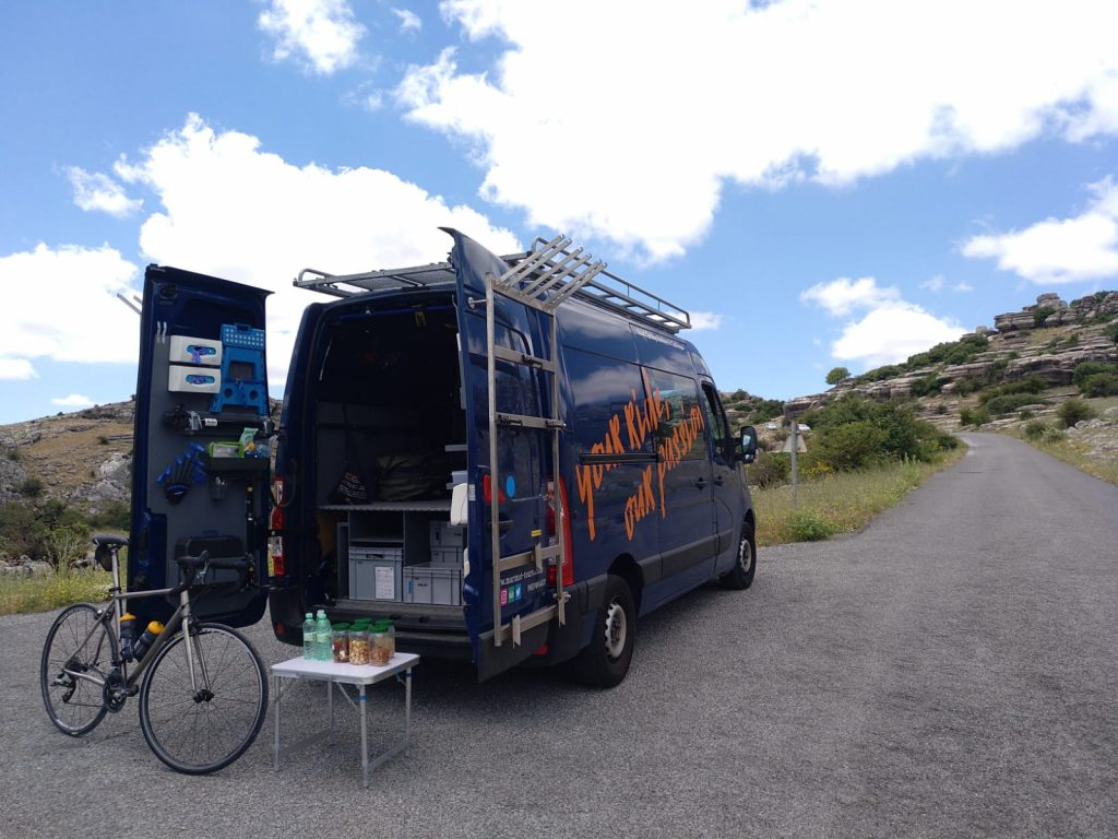 Marmot Tours van on El Torcal de Antequera Climb on guided cycling holiday Andalusia Spain