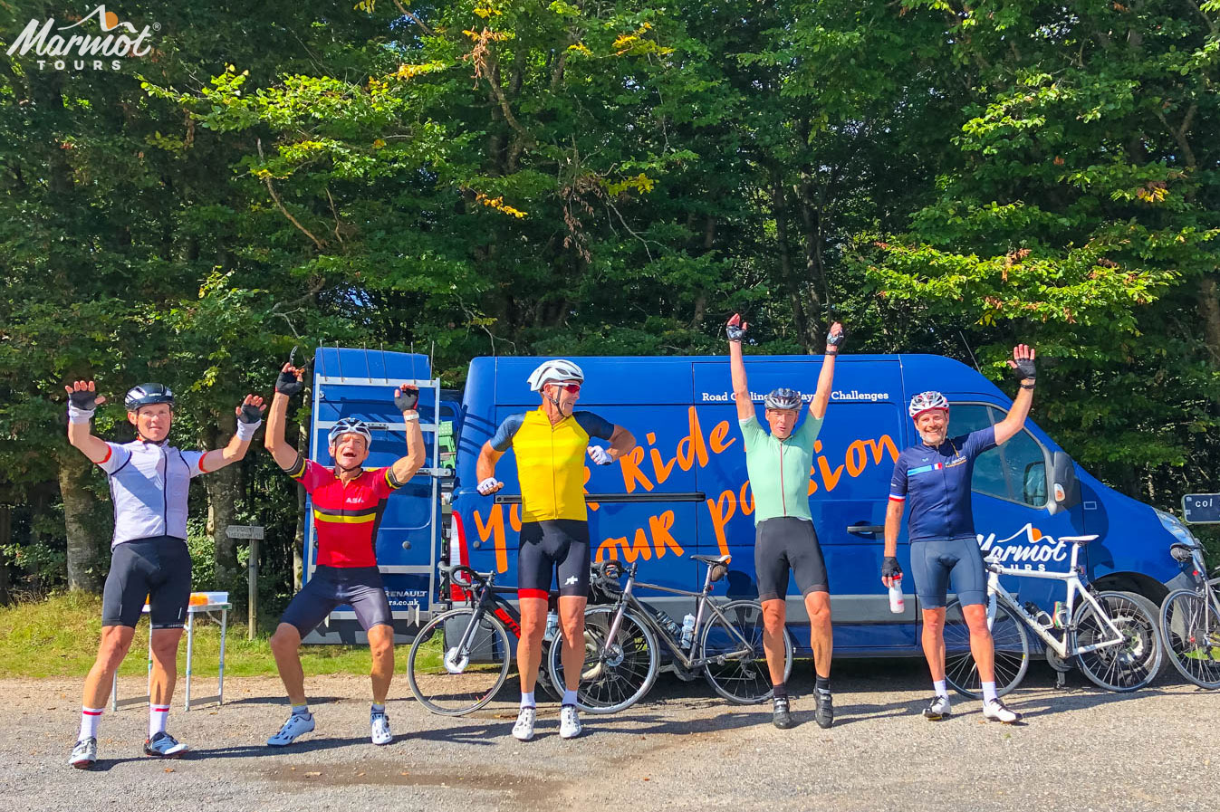 Cyclists jumping for joy on Marmot Tours cycling holidays in France