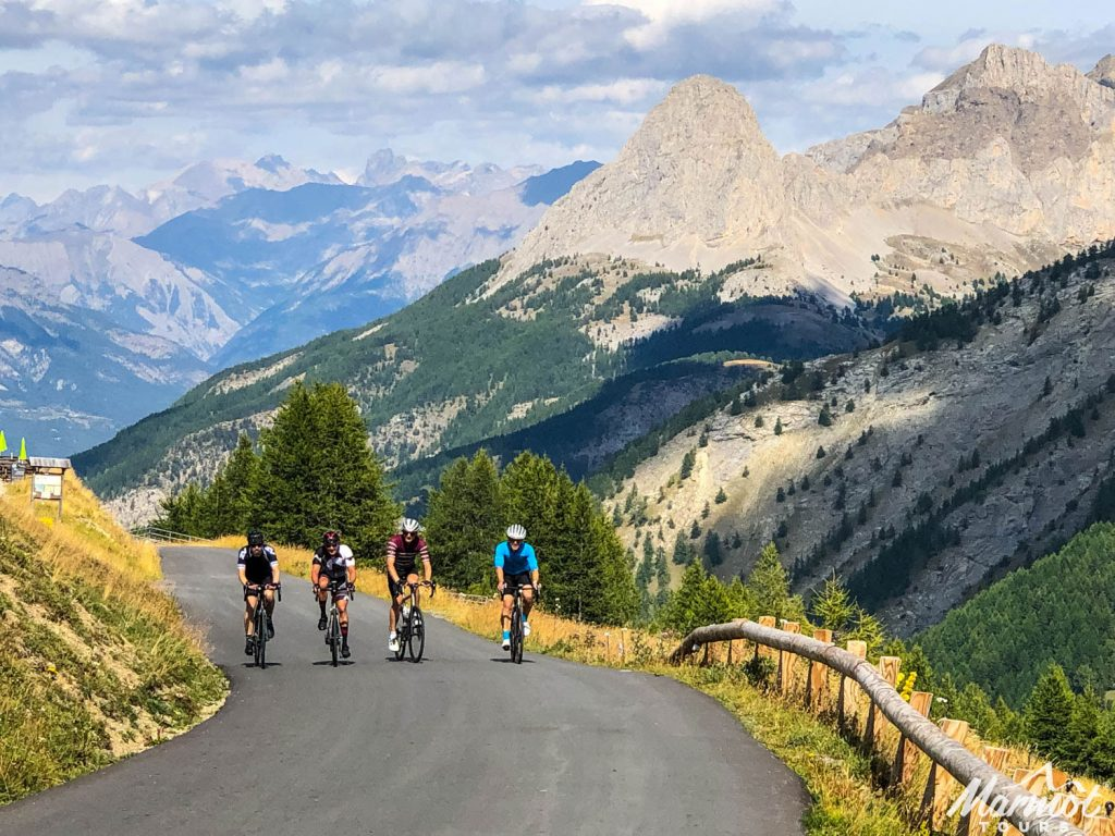 Four cyclists climbing in French Alps wth Marmot Tours European guided road cycling holidays